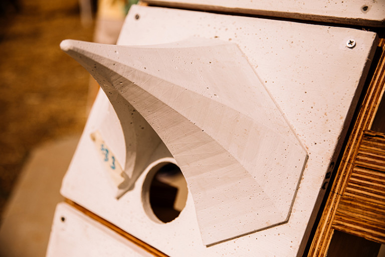 Protrusion of an exterior panel on the structure for the protection of bees