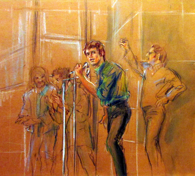 A sketch of a light-skinned man in a blue button-down and black trousers speaking into a microphone in a courtroom