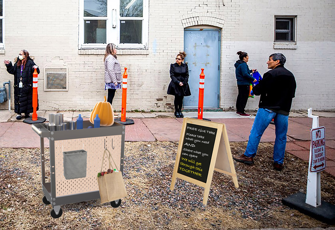 People wait on line along the outside of a building where a wheeled cart holds free items to take