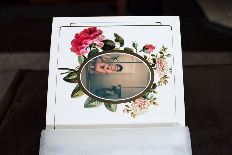 Horizontal picture of a mother and child with flowers around the frame