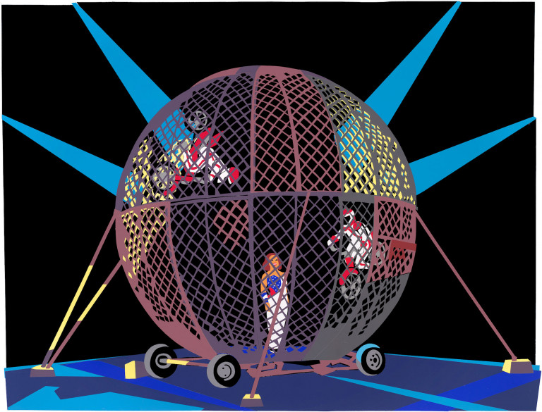 A large chain-linked cage in the shape of a globe contains two motorbikers riding its inner sides and a performer standing at its center, illuminated by four spotlights