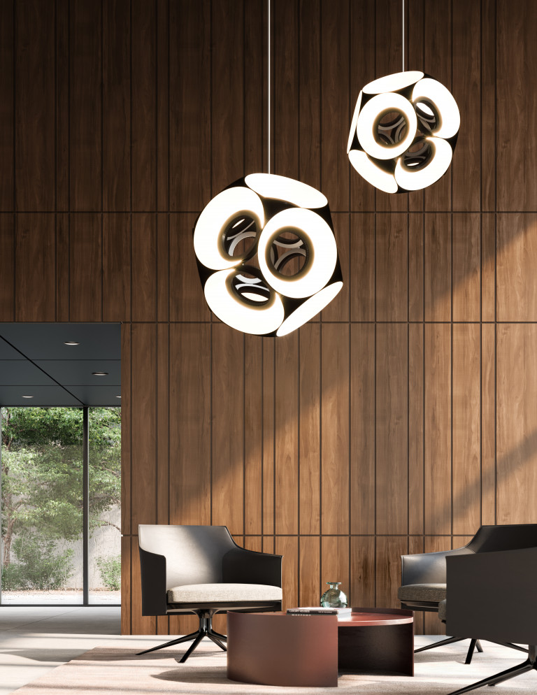 Pendant lamps of clustered illuminated circles hang above an arrangement of modern armchairs around a low table
