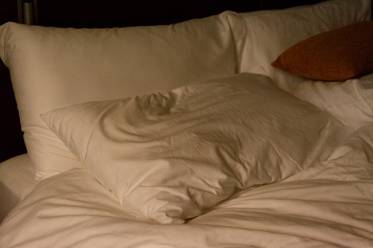 Picture of white pillows on a bed