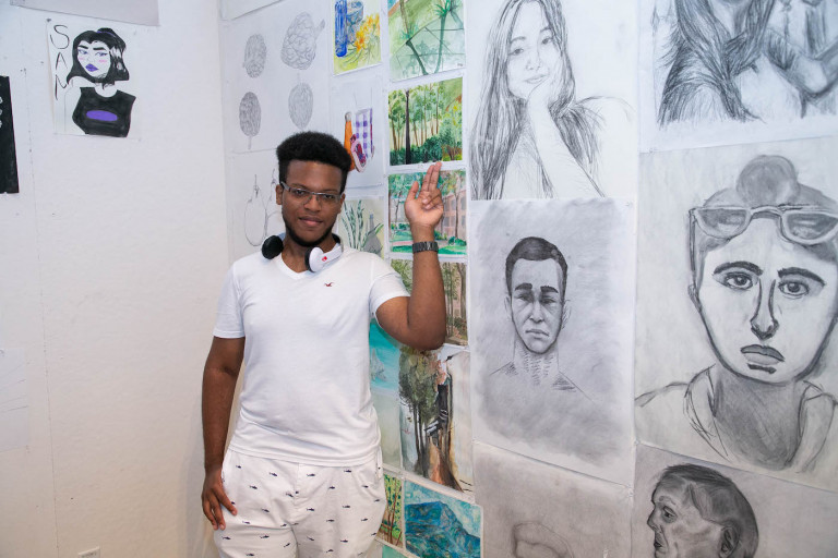 BAP Scholar Jeremy Broomes with his work (photo by Sam Stuart)