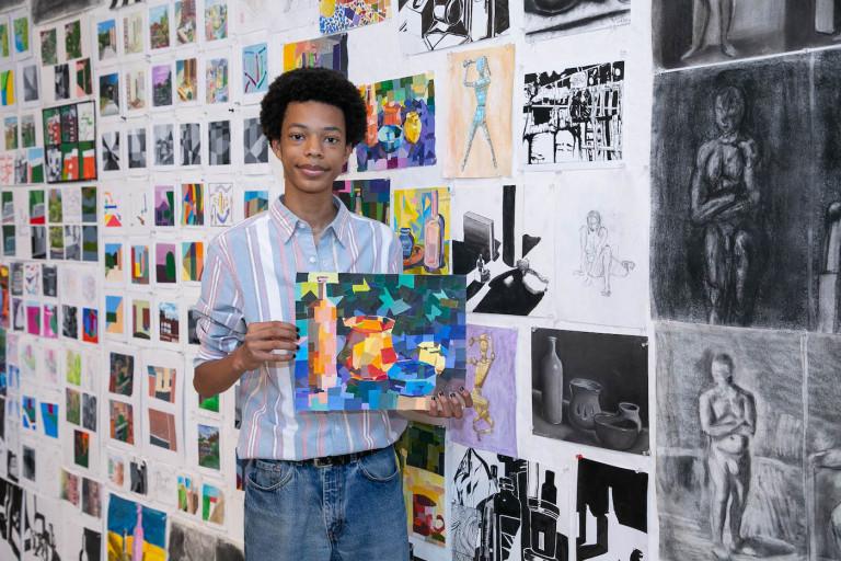 BAP Scholar Justin Thomas with his work (photo by Sam Stuart)
