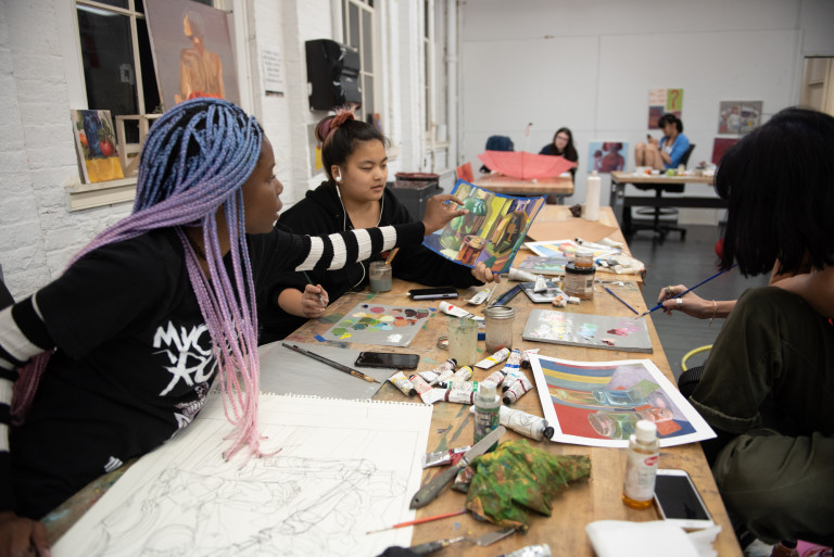 Picture of students working together on an art project