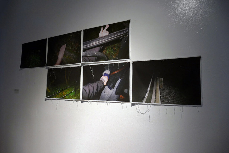 6 black pictures hanging on a white wall