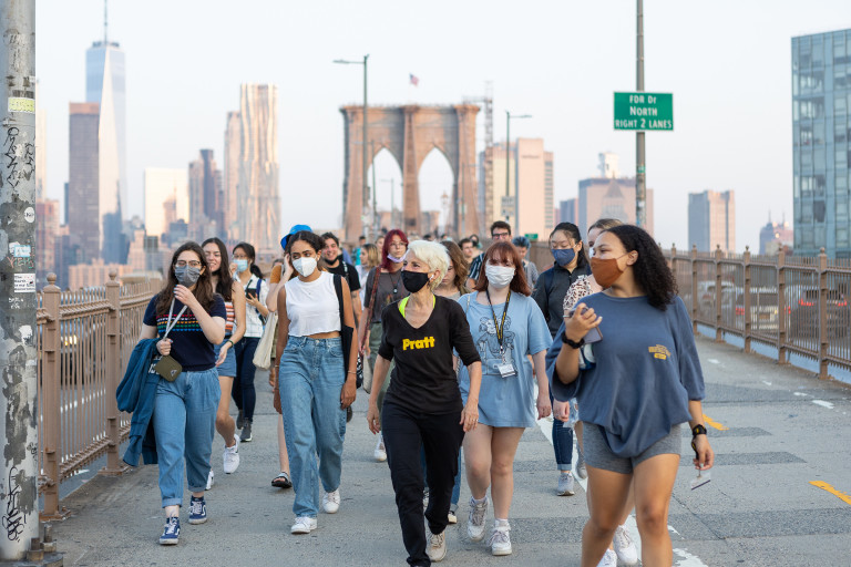 President Frances Bronet leading students over the Brooklyn Bridge (photo by Sam Stuart Hollenshead)