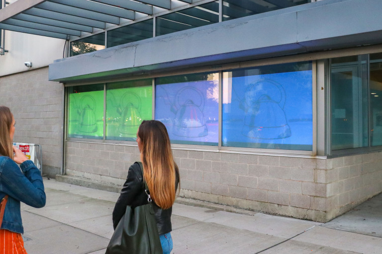 """""""Tea Time"""" by Amelia Johnson in the Film/Video Building windows (photo by Deniz Gonel)"""
